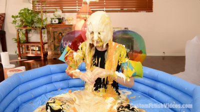 Condiments poured over Odette's wet and messy head