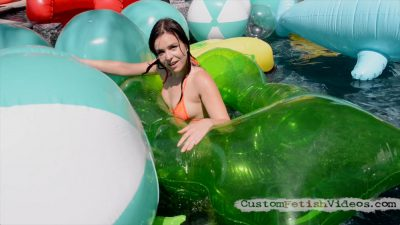 Juliette March is trying to capture allk of the beach balls and pop them