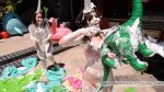 Juliette stabs an inflatable dinosaur while covered in shaving cream